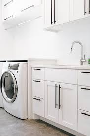 black pulls for white kitchen cabinets modern laundry alpine cabinetry alpine cabinetry