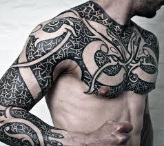 50 tribal chest tattoos for men masculine design ideas