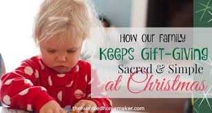 how our family keeps gift giving sacred and simple at christmas