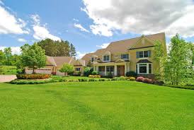 landscape house benefits of having a well maintained landscaped property