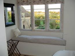mesmerizing bay windows with comfy mattress combined floral bed