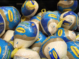 buying a turkey in a supermarket for thanksgiving editorial
