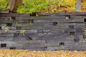 wooden leaves wall wooden retaining wall stock photo image of leaves wood 53928496