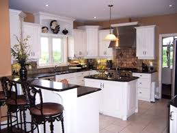 white cabinets with black countertops and appliances custom kitchen cabinets in white with black countertops