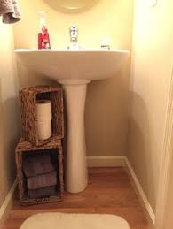 how to redo a bathroom sink nautical wood pilings to hide the pipes under the bathroom sink