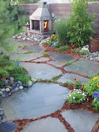 outdoor diy network yard crashers with fireplace and stone floor