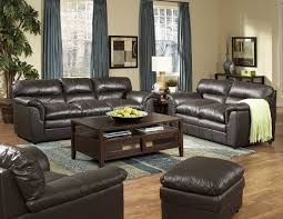 living room with dark brown leather couches contemporary with