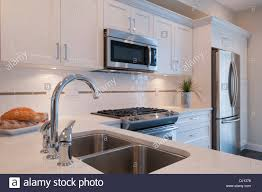 modern kitchen stove sink stove and built in microwave oven in modern kitchen surrey