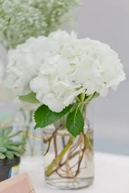 white flower centerpieces white and gold white and gold flower centerpiece