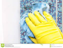 house chores wiping bathroom mirror with cleaning cloth stock