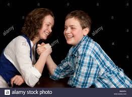 caucasian teenager boy and enjoying an arm wrestling