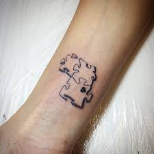 small puzzle piece heart tattoo on wrist