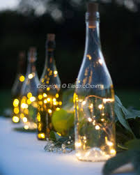wine bottle string lights outdoor patio party lighting outdoor party dinner table