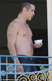 shirtless colin farrell shows his fading tattoos on cannes hotel