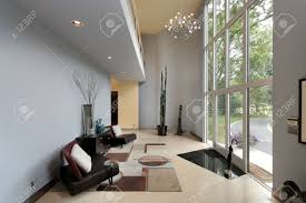 modern foyer with two story window and sitting area stock photo