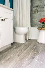 Gray Floor Bathroom - newly installed gray weathered wood plank tile flooring mudroom