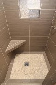 shower with gray tile bench and beachstone floor modern