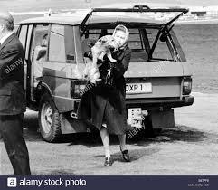queen elizabeth 11 with dog corgi range rover stock photo royalty