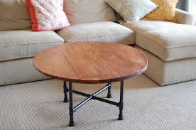 diy round cocktail table with reclaimed wood top and black pipe