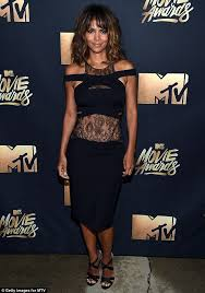 halle berry dazzles in intricate bodycon dress with lace panels at