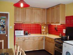 Red Walls In Kitchen - red accent wall in kitchen with brown cabinets google search