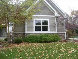 exterior painted cedar siding cedar shakes above house garage door