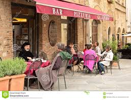 Montepulciano Italy Map by People Sitting In A Small Cafe Outside In The Medieval Town Of