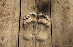 carved wood plank footprints are carved into the floorboards by monk who has prayed