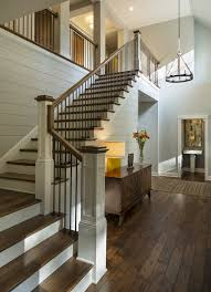 Banister Options Entryway With Rustic Wood Floors L Shaped Stairway Shiplap Wall