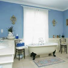blue bathroom design ideas with white sheer curtains and clawfoot