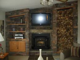 custom stone fireplace with shelves cupboard and wood box