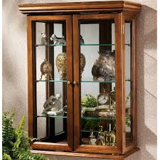 are curio cabinets out of style kimberley country tuscan wall mounted curio cabinet making my