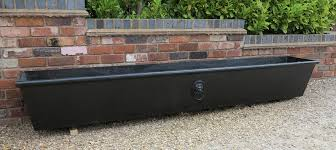 cast iron tapered garden planter or trough