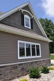 Home Exterior Design Stone Beautiful Dark Siding Home With Stoned Wainscot Price Cut Cobble