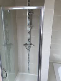 bathroom fitting bury bathroom installations bury kitchen new bathroom suite in the purity range in hi gloss white with a corner bath so the customer can look out at her view over the fields walk in shower with