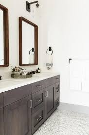 espresso stained dual bath vanity with vintage bronze faucets