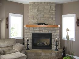 classy living room design with gray brick stone fireplace mantel