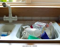 Pile Dirty Dishes In Kitchen Stock Photos  Pile Dirty Dishes In - Dirty kitchen sink