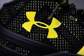 under armour takes 23 million charge because of sports authority