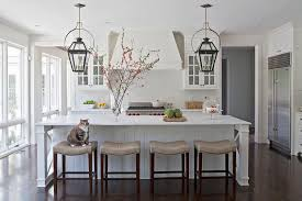white kitchen with taupe leather counter stools transitional