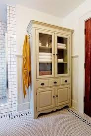 A Bathroom Adds Light No Windows Needed Bathroom Storage - Bathroom linen storage cabinets