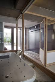Rustic Bedroom Doors - architecture bedroom loft in paris by olivier chabaud architects