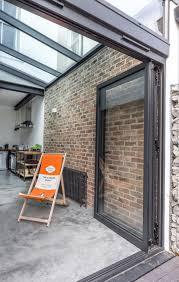 aluminium folding doors contemporary glass sleek glass roof to