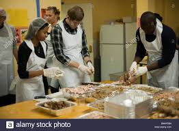 volunteers prepare and serve thanksgiving dinner to the neediest