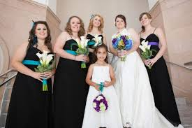 show me pictures of your bridesmaid dresses in black please