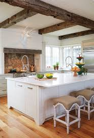 stone countertops rustic white kitchen cabinets lighting flooring
