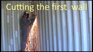 cutting the first internal wall of shipping container house loversiq