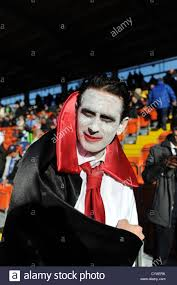brighton and hove albion football fan wearing dracula halloween