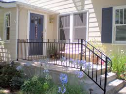 front house railing design and white concrete porch with black