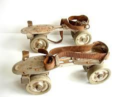 vintage adjustable metal roller skates with leather straps